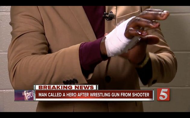James Shaw, Jr. shows off his bandaged hand after disarming a gunman early Sunday