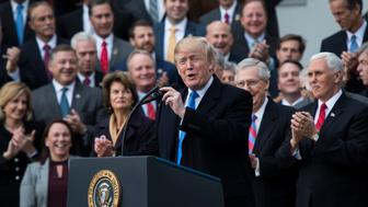 WASHINGTON, DC - DECEMBER 20: President Donald Trump with Senate Majority Leader Mitch McConnell of Ky., Vice President Mike Pence, House Speaker Paul Ryan of Wis., and Sen. Tim Scott, R-S.C., speaks about the passage of the tax bill on the South Lawn at the White House in Washington, DC on Wednesday, Dec. 20, 2017. (Photo by Jabin Botsford/The Washington Post via Getty Images)