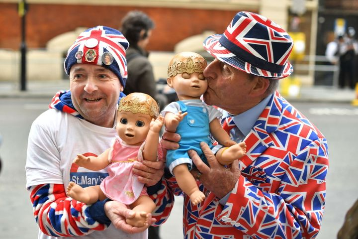 Royal fans John Loughrey (left) and Terry Hutt hold dolls outside the Lindo Wing at St Mary's Hospital in Paddington, London, where the Duchess of Cambridge has been admitted in the early stages of labour.