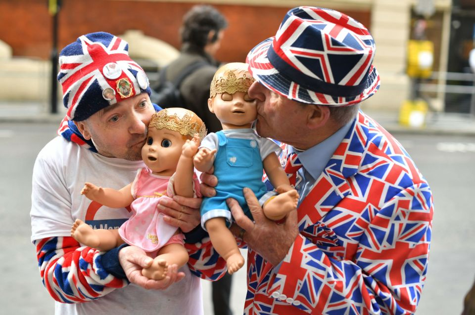John Loughrey, left, and Terry Hunt show off their robotic baby dolls outside St Mary's Hospital in