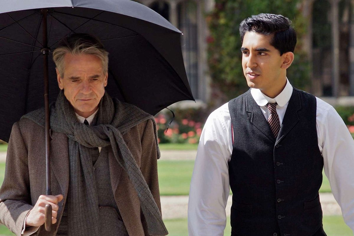 """The Man Who Knew Infinity"":  Jeremy Irons as  G.H. Hardy, left, and Dev Patel  as  Srinivasa Ramanujan   walk through the Quad at Trinity College, Cambridge. (Photo: Richard Blanshard / IFC Films)"