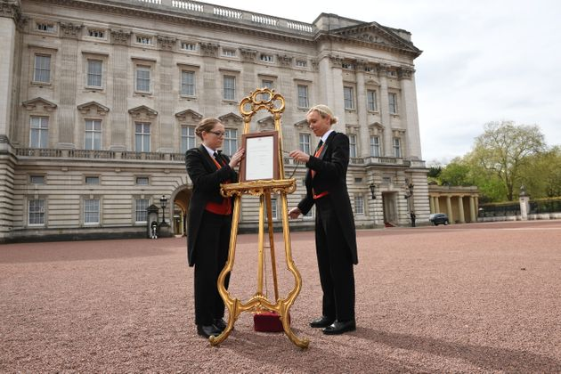 A notice is placed on an easel in the forecourt of Buckingham Palace in London to formally announce the...