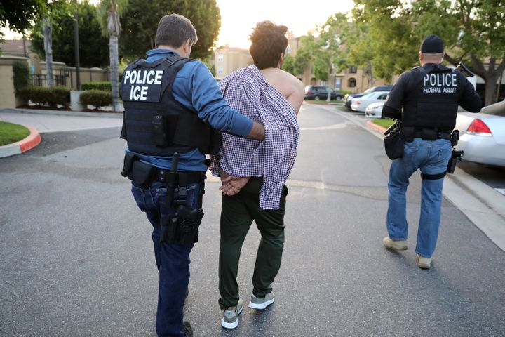 An Immigration and Customs Enforcement assistant field office director arrests an Iranian immigrant in San Clemente, Californ