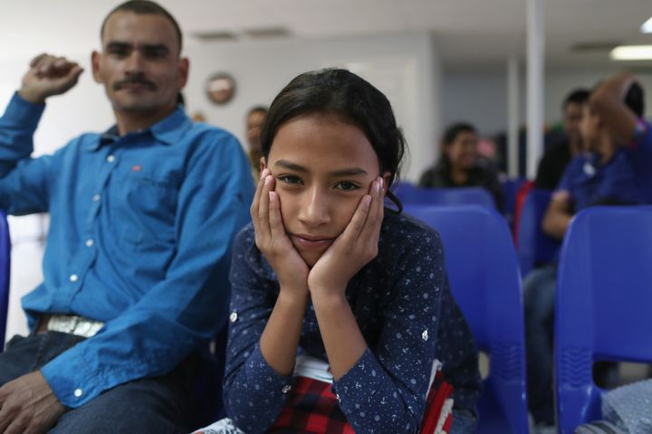 A father and daughter from Honduras wait for assistance at the Immigrant Respite Center after they were released from U.S. im