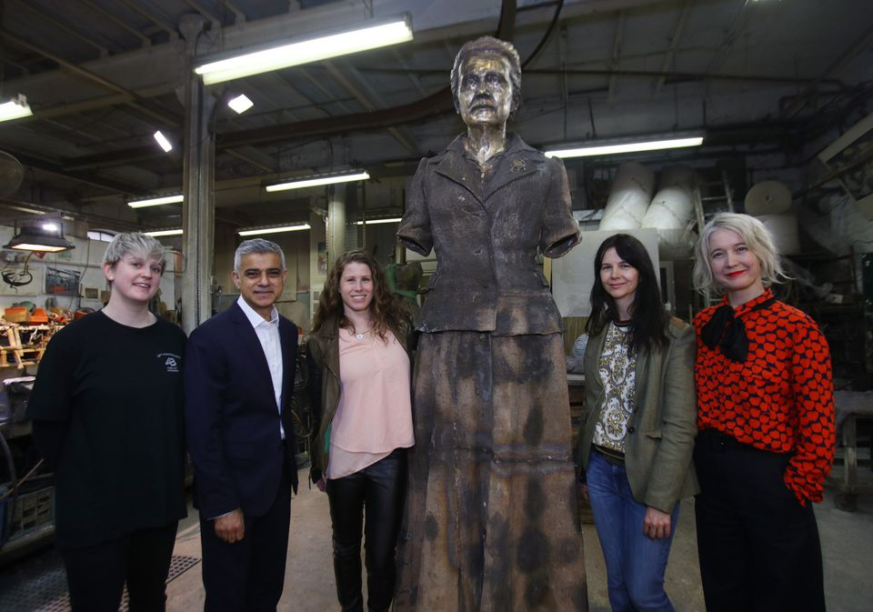 Technician Chloe Hughes, Mayor of London Sadiq Khan, Caroline Criado-Perez, artist Gillian Wearing, and Deputy Mayor for Culture and Creative Industries Justine Simons, during a visit to AB Fine Art Foundry, in east London, to see the finishing touches to a statue of suffragist leader Millicent Fawcett before its unveiling in Parliament Square.