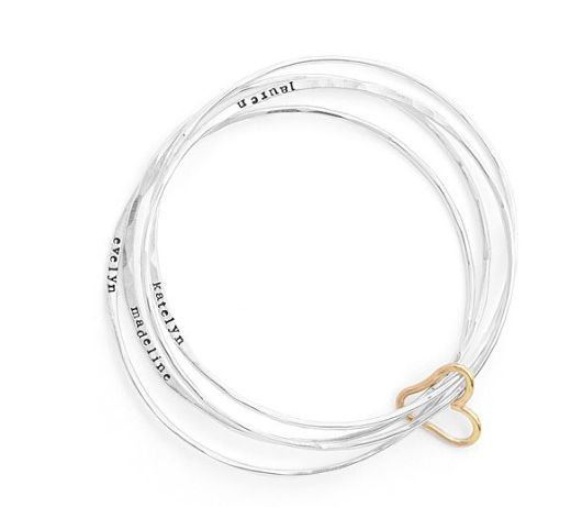 """Get it at <a href=""""https://www.uncommongoods.com/product/personalized-all-heart-bangle-set"""" target=""""_blank"""">Uncommon Goods</a"""