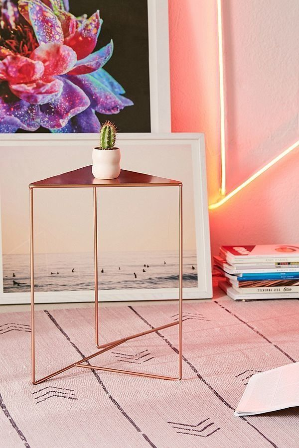 """Get it from <a href=""""https://www.urbanoutfitters.com/shop/triangle-side-table"""" target=""""_blank"""">Urban Outfitters</a>."""