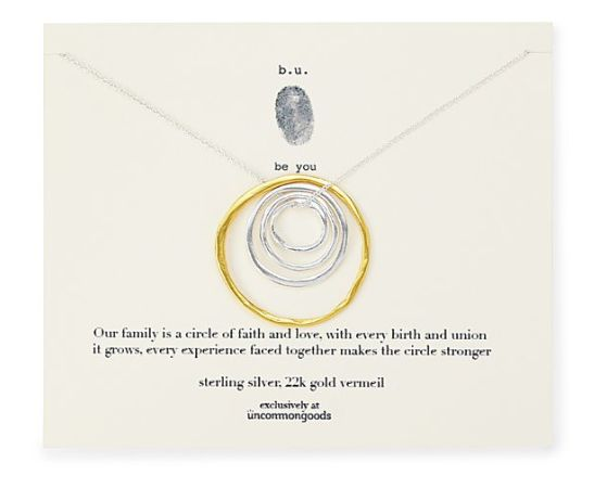 """Get it at <a href=""""https://www.uncommongoods.com/product/circle-of-life-nesting-rings-necklace"""" target=""""_blank"""">Uncommon Good"""