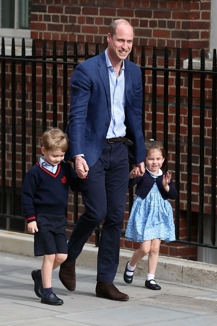Prince William arrives at St. Mary's Hospital with Prince George and Princess Charlotte to see the new baby.