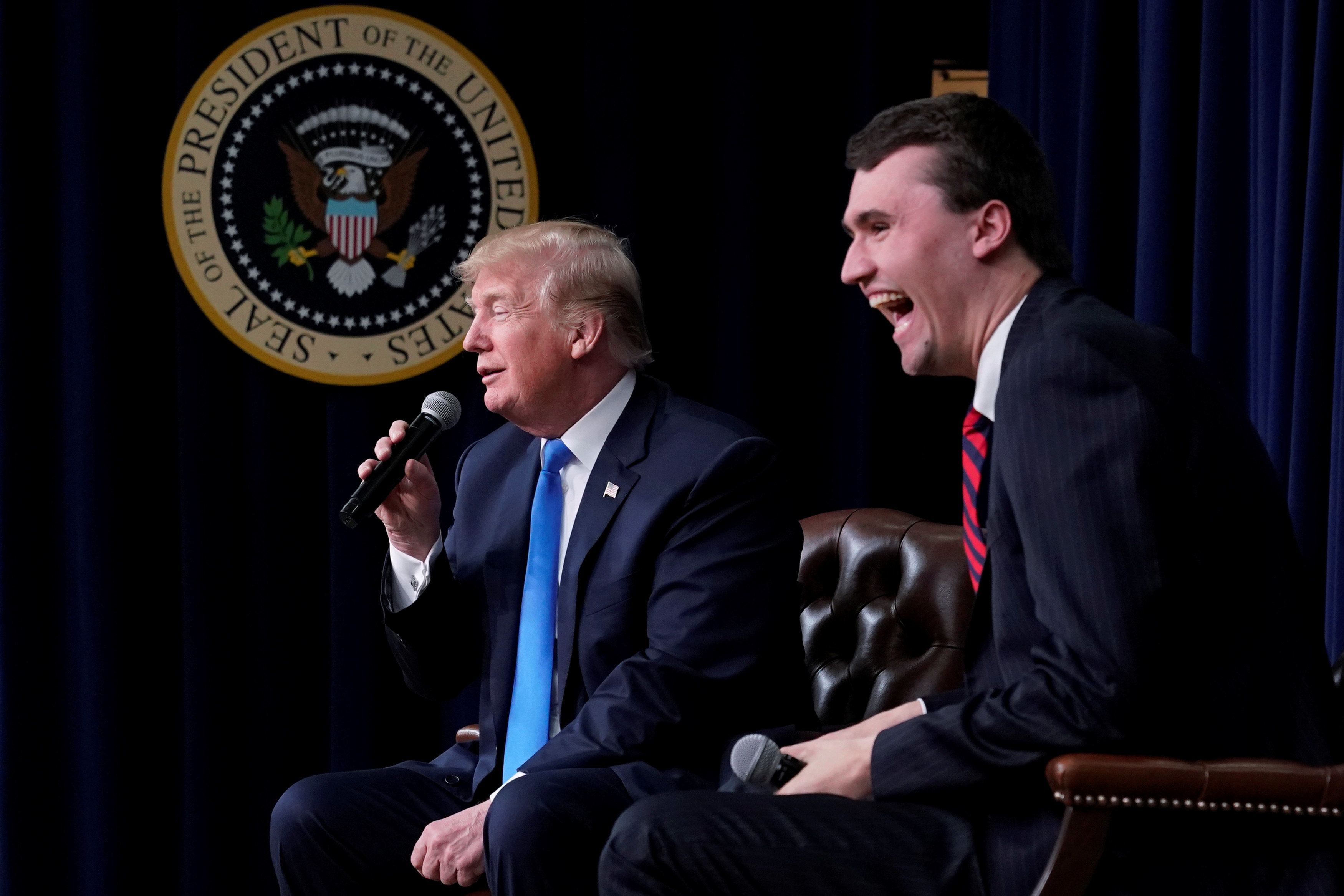 Charlie Kirk, founder of Turning Point USA, laughs after U.S. President Donald Trump said that if he could go back in time and give himself advice at age 25 it would be to not run for president, during a youth forum titled Generation Next, at the White House in Washington, U.S. March 22, 2018.  REUTERS/Jonathan Ernst