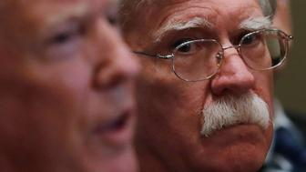 U.S. President Donald Trump receives a briefing from senior military leadership accompanied by his new National Security Adviser John Bolton at the Cabinet Room of the White House in Washington, DC, U.S. April 9, 2018. REUTERS/Carlos Barria