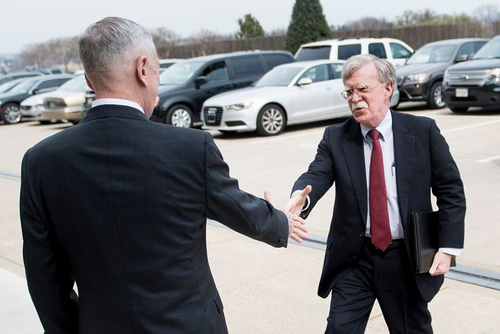 Secretary of DefenseJim Mattis, left, greets incoming national security adviser John Bolton outside the Pentagon on Mar