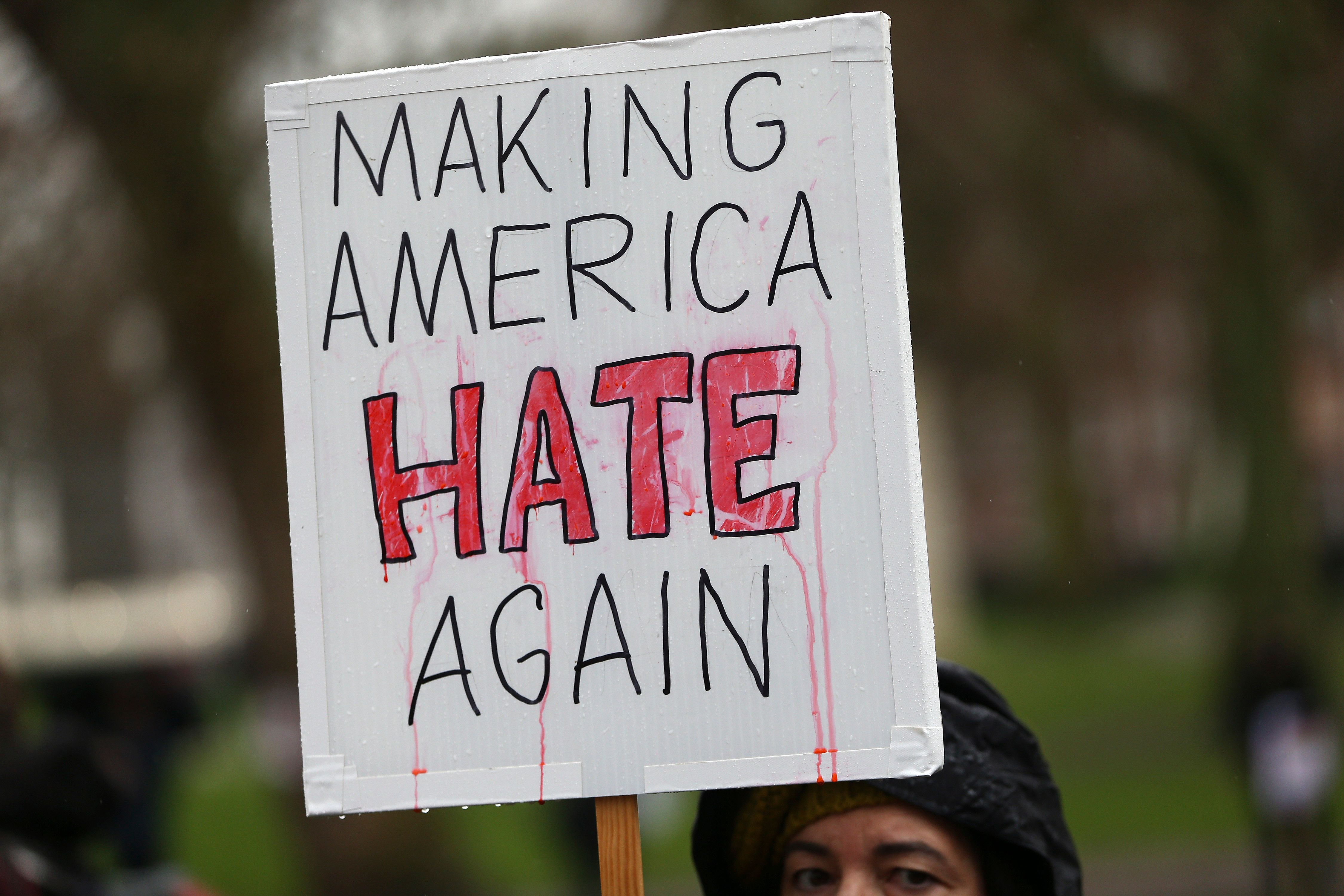 "A demonstrator holds a banner that reads ""Making America Hate Again"", during a march against U.S. President Donald Trump and his temporary ban on refugees and nationals from seven Muslim-majority countries from entering the United States, in London, Britain, February 4, 2017. REUTERS/Neil Hall"