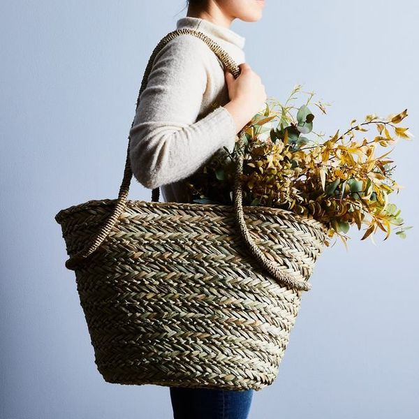 """Get it at <a href=""""https://food52.com/shop/products/4683-seagrass-market-tote-with-linen-liner"""" target=""""_blank"""">Food 52</a>."""