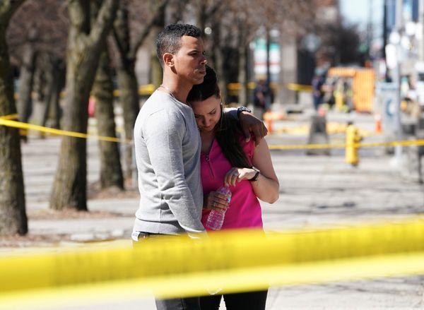 People reactnear the scene of the crash.