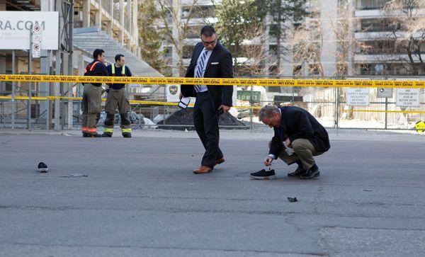Toronto police investigate the scene of the crash.