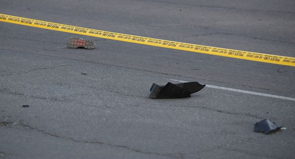 Shoes from victims are strewn across the scene.