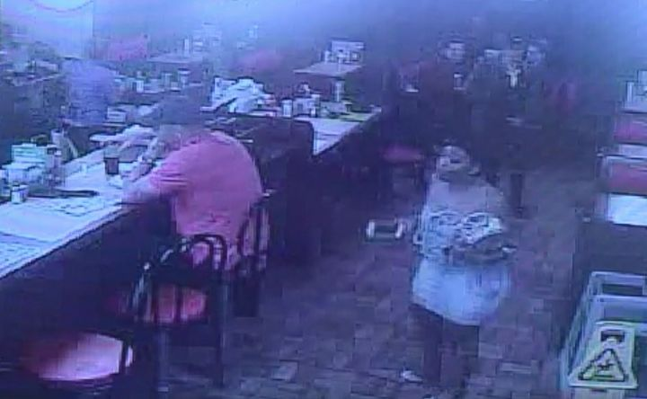 A still taken from a Waffle House surveillance video shows Chikesia Clemons approaching the restaurant's front counter.