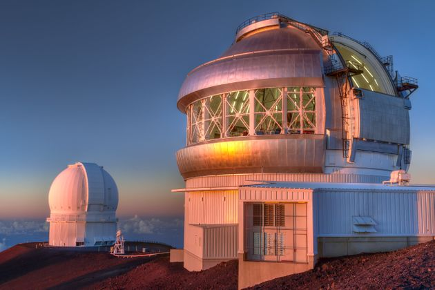 The Gemini North telescope, right, in