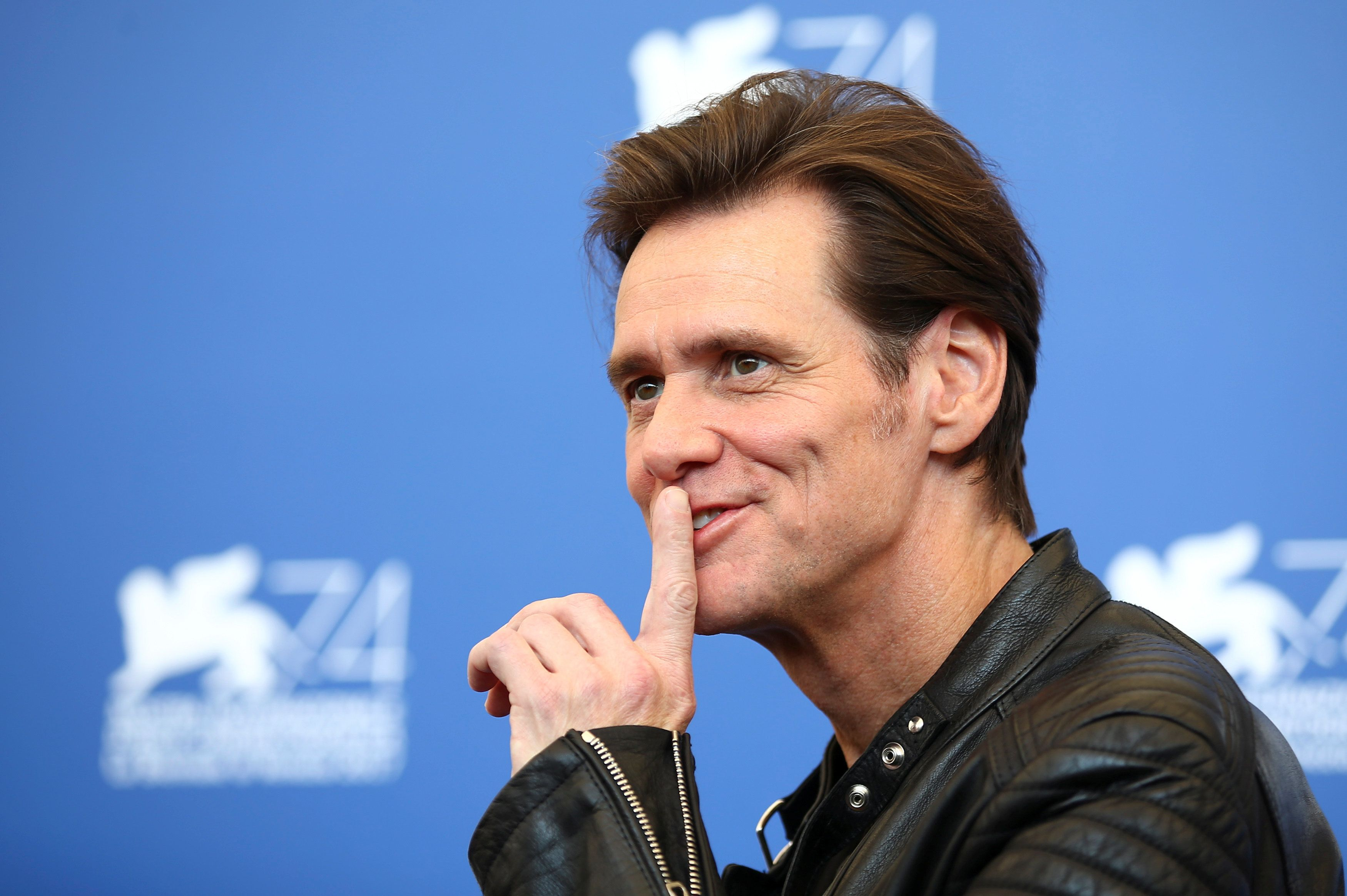"""Actor Jim Carrey poses during a photocall for the movie """"Jim & Andy: The Great Beyond"""" at the 74th Venice Film Festival in Venice, Italy September 5, 2017. REUTERS/Alessandro Bianchi"""