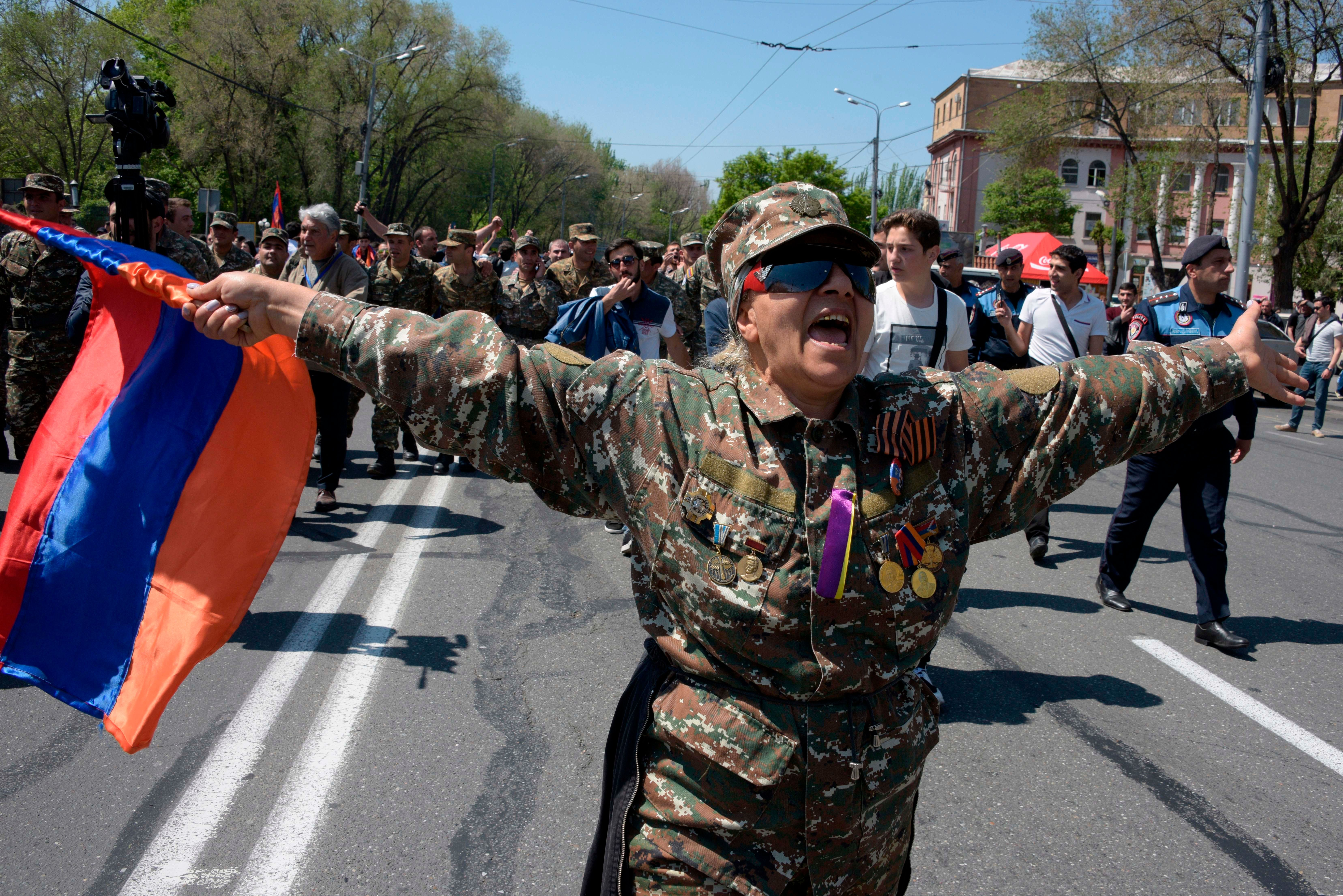 Demonstrators march through the streets of Yerevan on April 23, 2018, to protest the former president's election as prime minister. - Hundreds of opposition supporters took to the streets of Armenia's capital on April 23, 2018 amid rising political turmoil as the whereabouts of the protest leader remained unclear a day after he was detained. (Photo by KAREN MINASYAN / AFP)        (Photo credit should read KAREN MINASYAN/AFP/Getty Images)