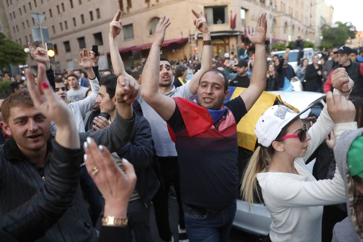 People celebrate in in central Yerevan after Prime Minister Serzh Sargsyan announced his resignation following mass protests.