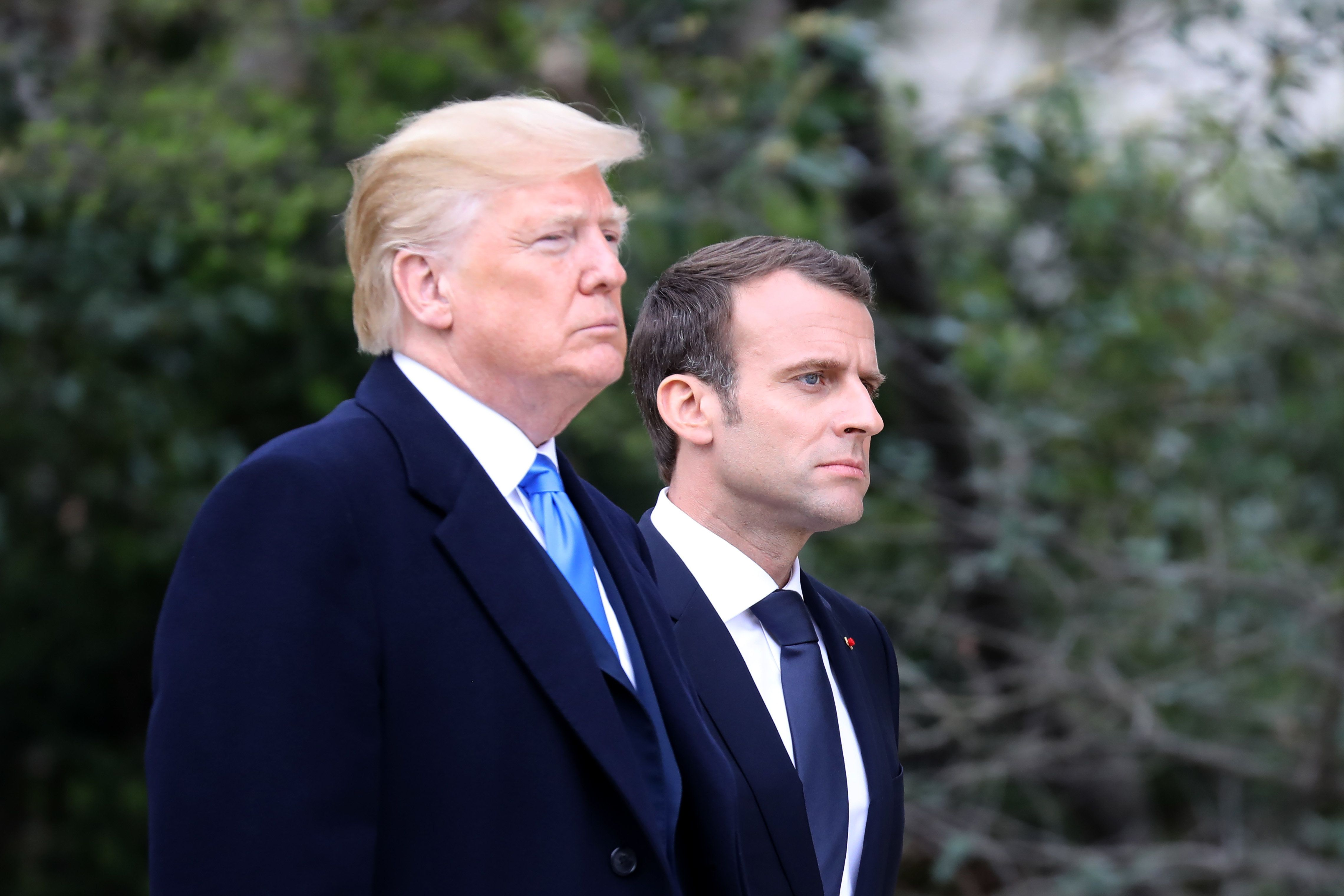 TOPSHOT - US President Donald Trump walks with French President Emmanuel Macron at Mount Vernon, the estate of the first US President George Washington, in Mount Vernon, Virginia, April 23, 2018. (Photo by Ludovic MARIN / AFP)        (Photo credit should read LUDOVIC MARIN/AFP/Getty Images)