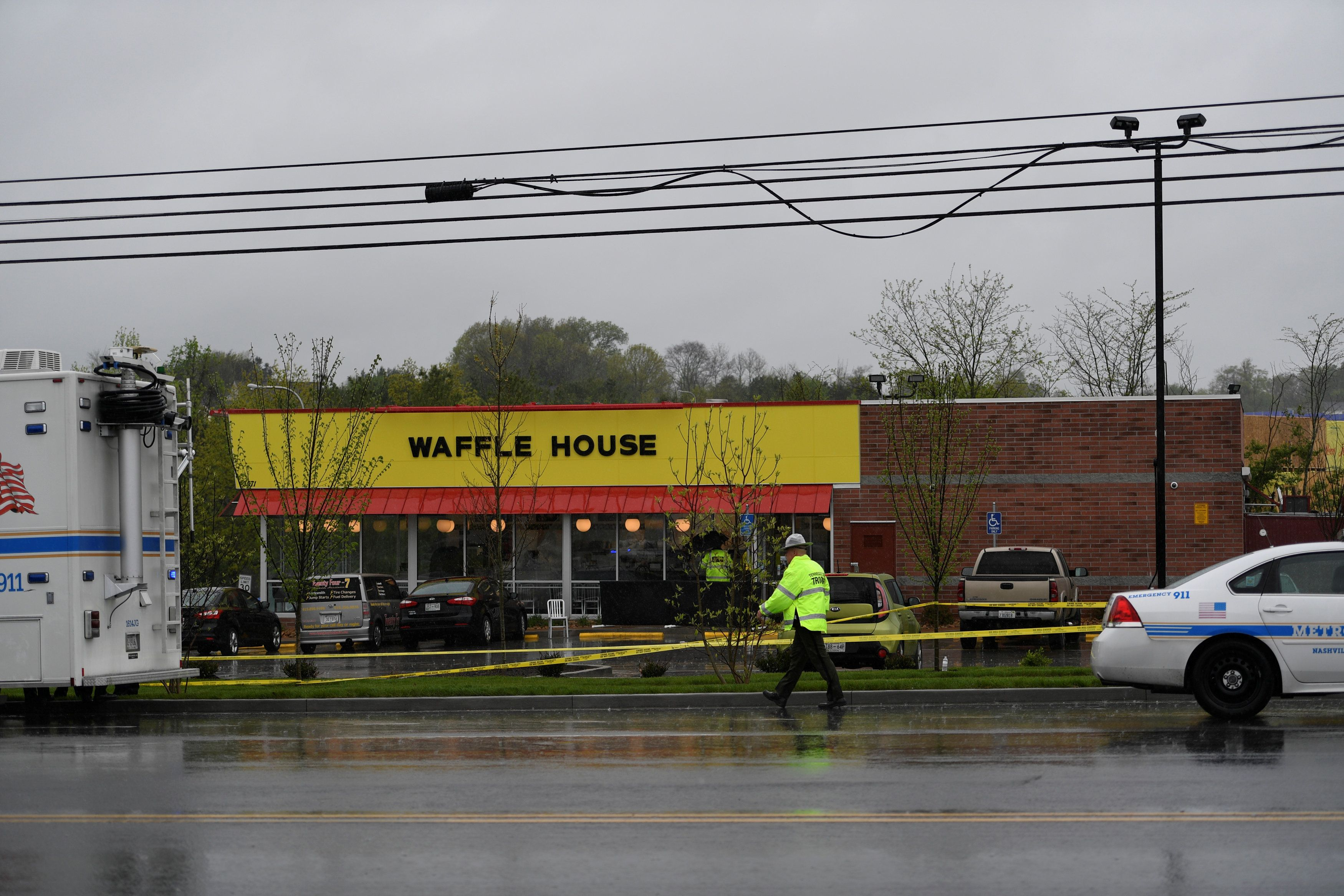 Metro Davidson County Police inspect the scene of a fatal shooting at a Waffle House restaurant near Nashville, Tennessee, U.S., April 22, 2018.  REUTERS/Harrison McClary