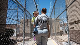 CHIHUAHUA, MEXICO, May 10, 2017 | In most parts of Mexico, mothers behind bars can keep their children's up up to age 3 or 4. This mother was an accountant who is in a state prison for fraud and is awaiting sentencing. She walks back to her cell for roll call and lunch after two hours of art workshops, where she makes barrettes and decorated boxes while her daughter plays by her side the whole time.