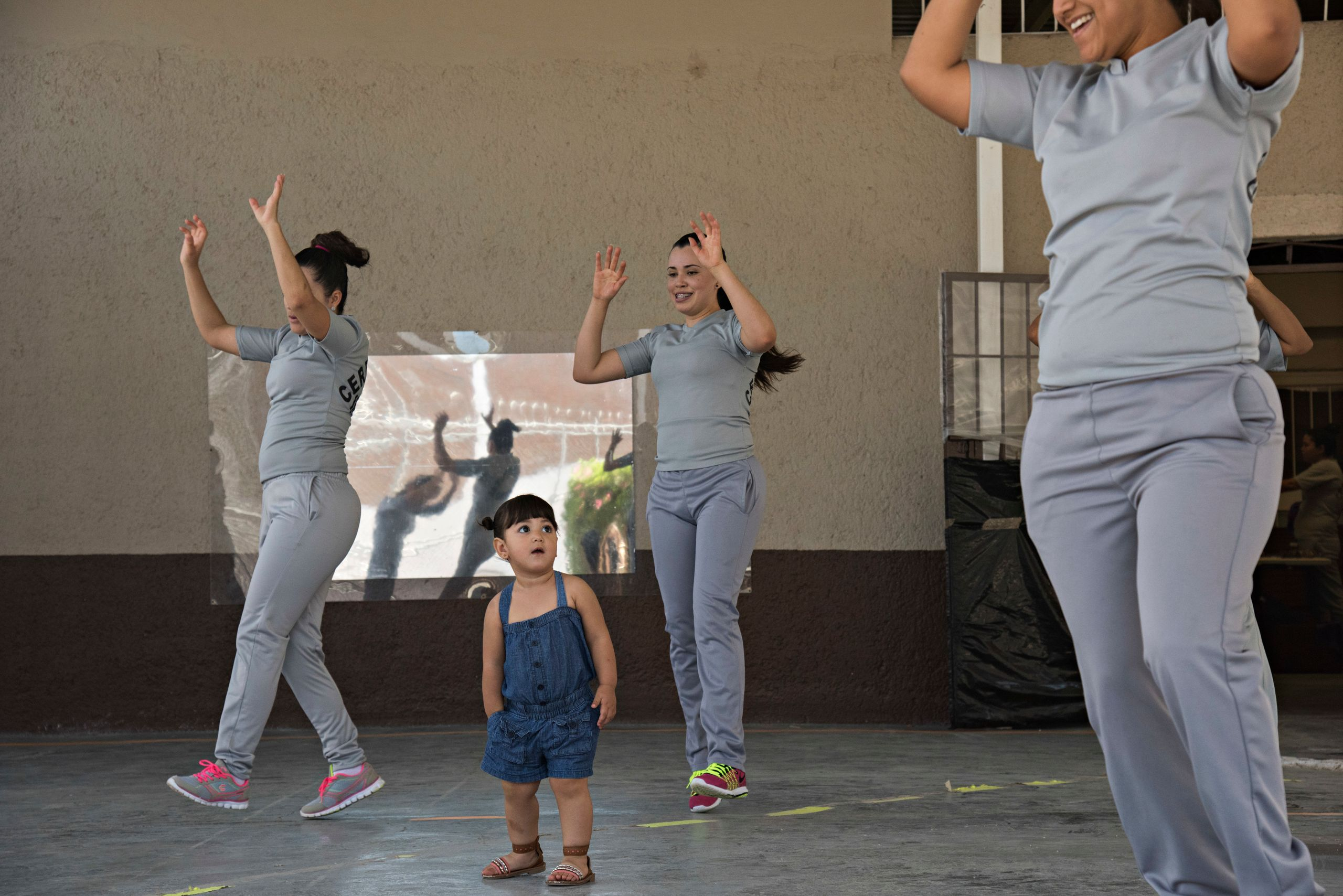 Melissa wanders through a room of dancing women during a morning Zumba class in the women's prison. Authorities arrested her