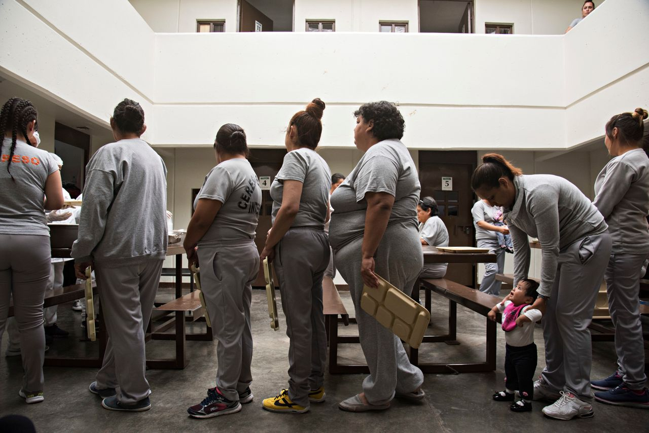 Women line up for lunch in the common area of the living quarters in the women's state prison in Chihuahua City, Mexico.