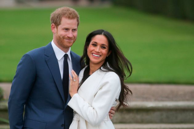 Prince Harry and Meghan Markle pose for a photo after announcing their engagement on Nov. 27,