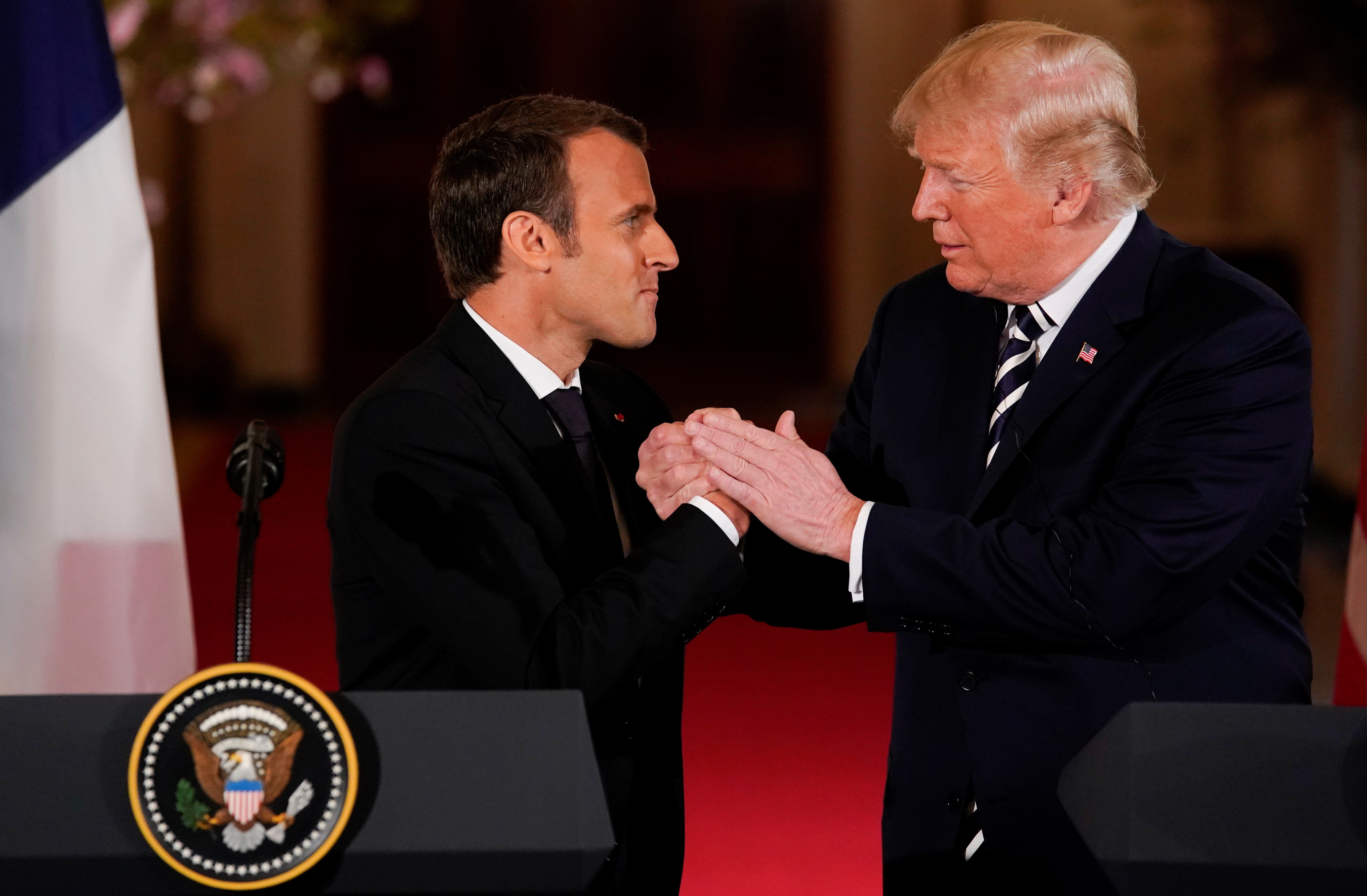 Trump Shared One Awkward Kiss And Handshake With Emmanuel Macron