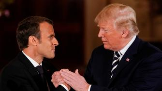 U.S. President Donald Trump shakes hands with French President Emmanuel Macron after their joint news conference at the White House in Washington, U.S., April 24, 2018. REUTERS/Jonathan Ernst