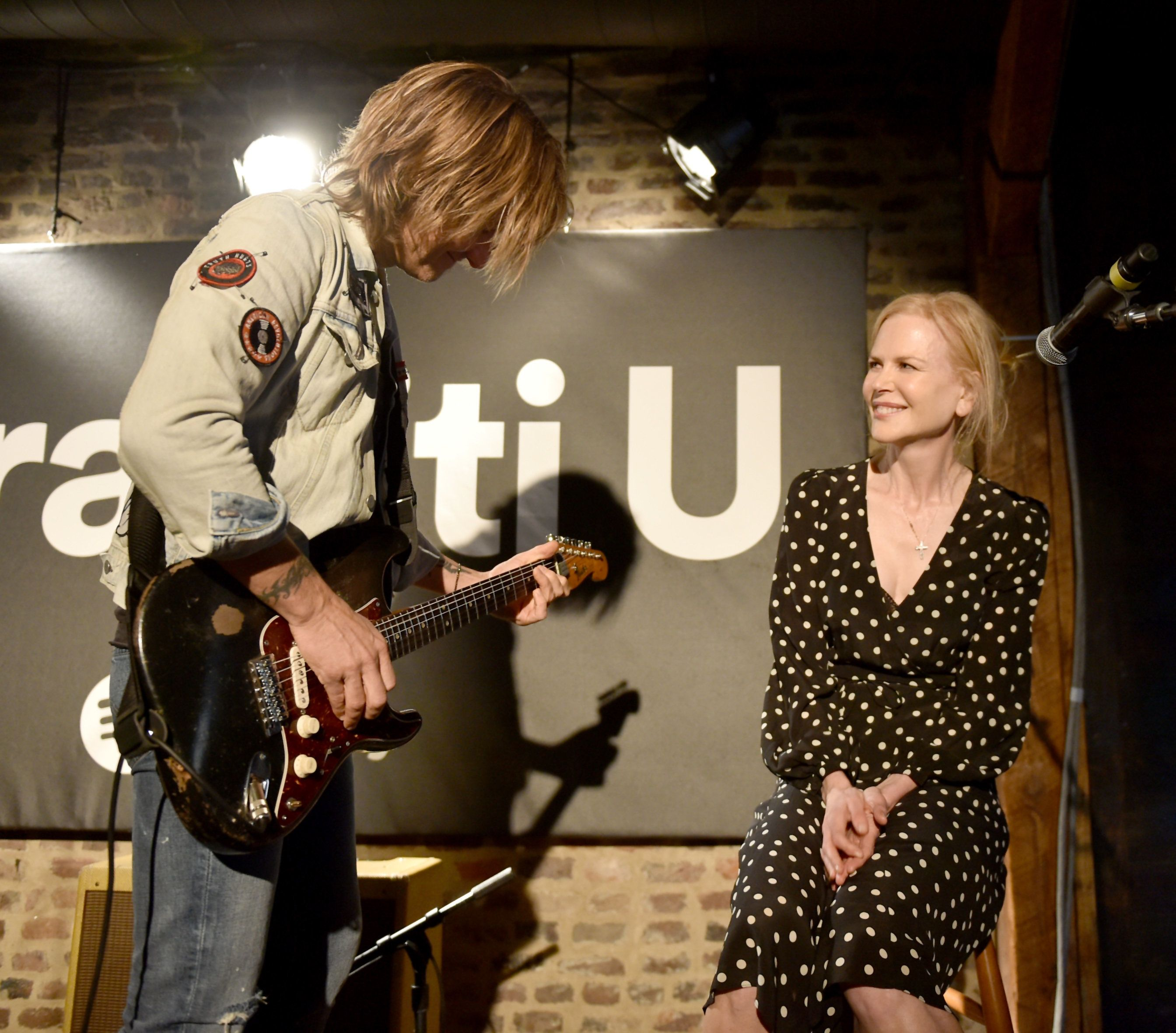 NASHVILLE, TN - APRIL 23:  Keith Urban (L) and wife Nicole Kidman (R) perform onstage for a spotify fans first event at Houston Station on April 23, 2018 in Nashville, Tennessee.  (Photo by John Shearer/Getty Images for Spotify)