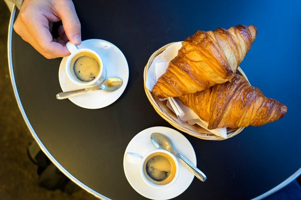 From croissants and espresso at a <i>brasserie</i>to cheese samples from a<i>fromagerie, </i>Paris is a non-negot