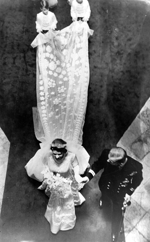 """The future queen wore a gown decorated with crystals and 10,000 seed pearls,<a href=""""https://www.royalcollection.org.uk"""