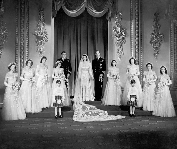The couple with Elizabeth'seight bridesmaids in the throne room at Buckingham Palace, including her sister, Princess Ma