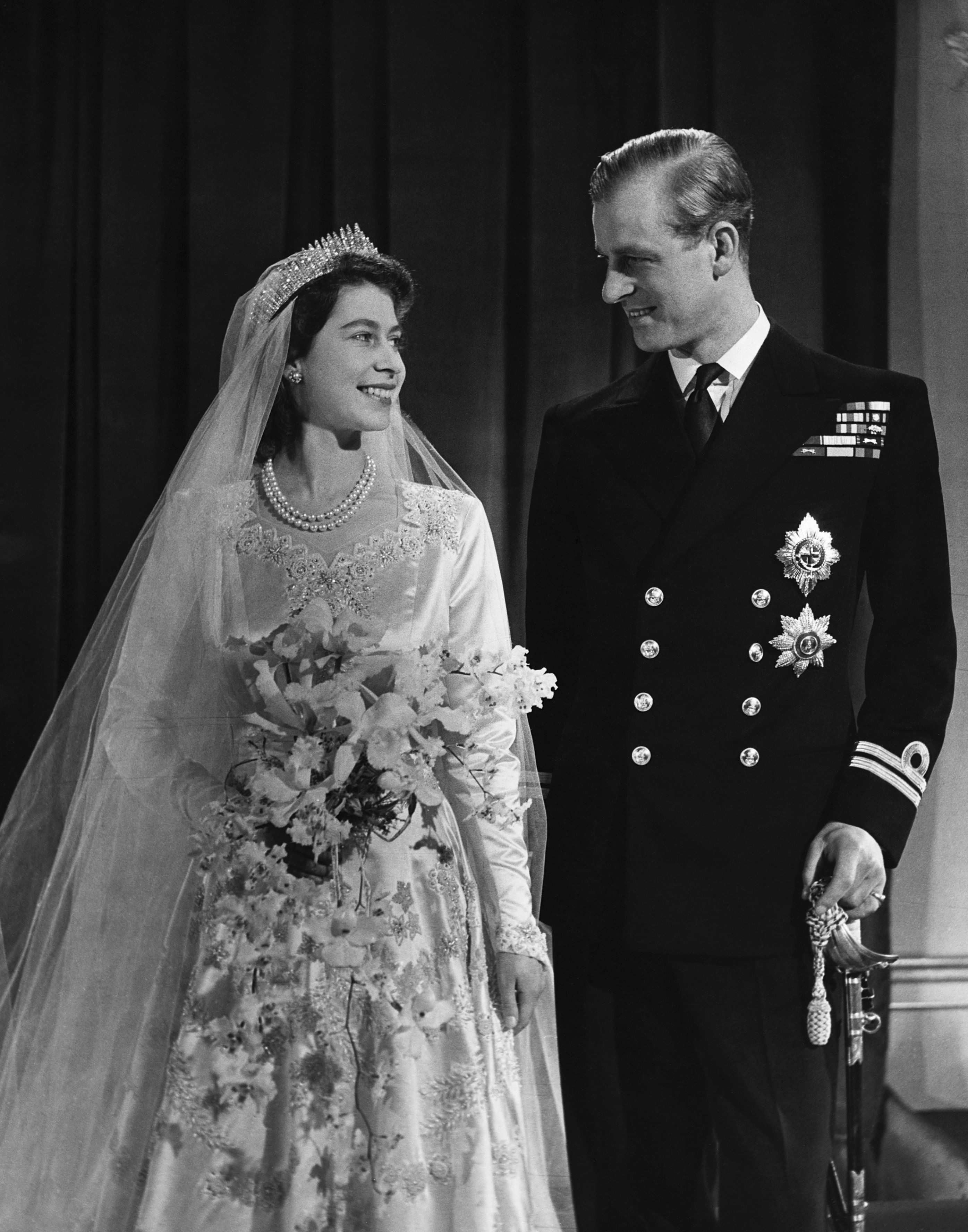 Princess Elizabeth, later Queen Elizabeth II with her husband Phillip, Duke of Edinburgh, after their marriage, 1947. (Photo by © Hulton-Deutsch Collection/CORBIS/Corbis via Getty Images)