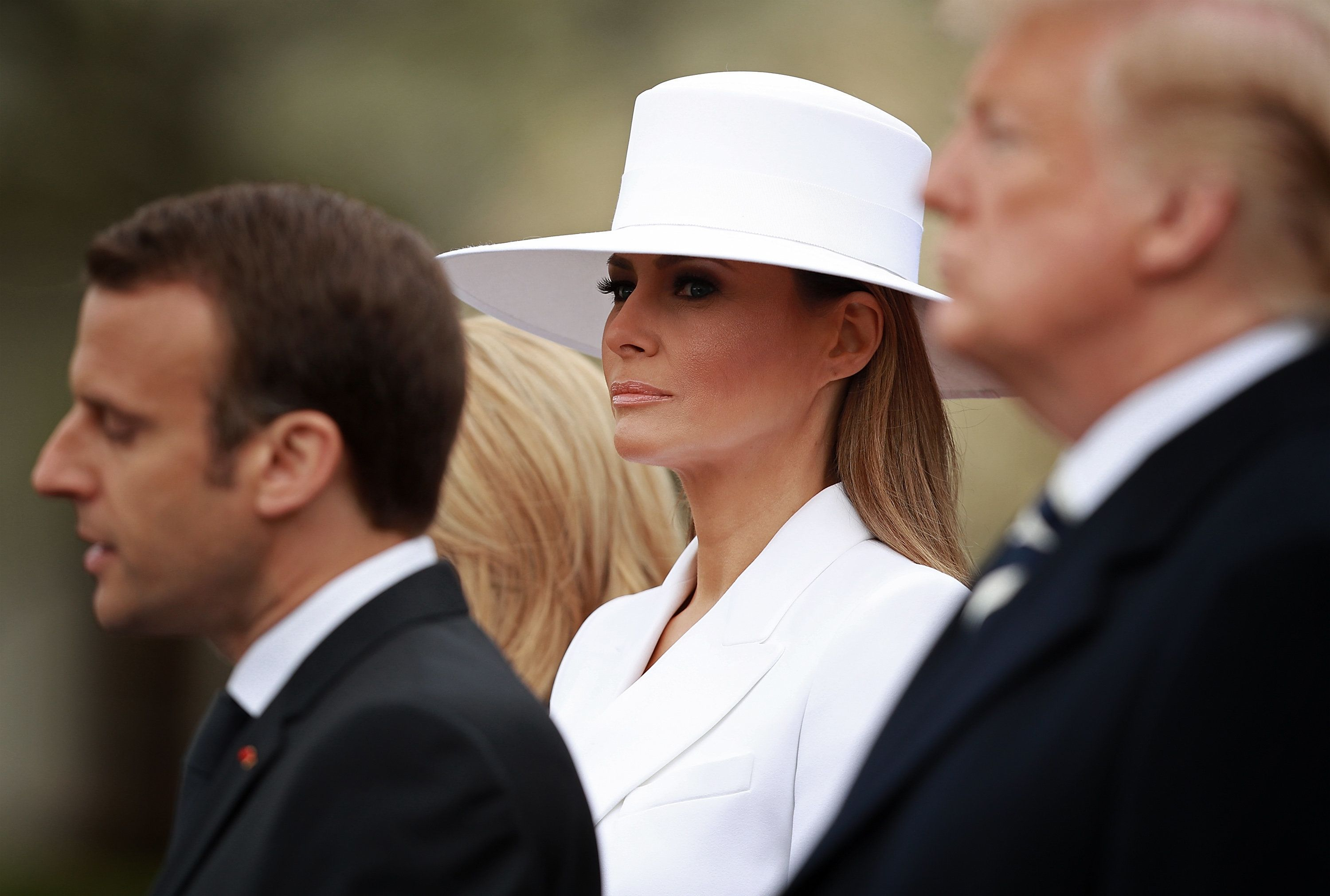 WASHINGTON, DC - APRIL 24:  U.S. first lady Melania Trump listens as French President Emmanuel Macron (L) speaks during a state arrival ceremony at the White House with U.S. President Donald Trump April 24, 2018 in Washington, DC. Macron and Trump are scheduled to meet throughout the day to discuss a range of bilateral issues as Trump holds his first official state visit with the French president.  (Photo by Chip Somodevilla/Getty Images)