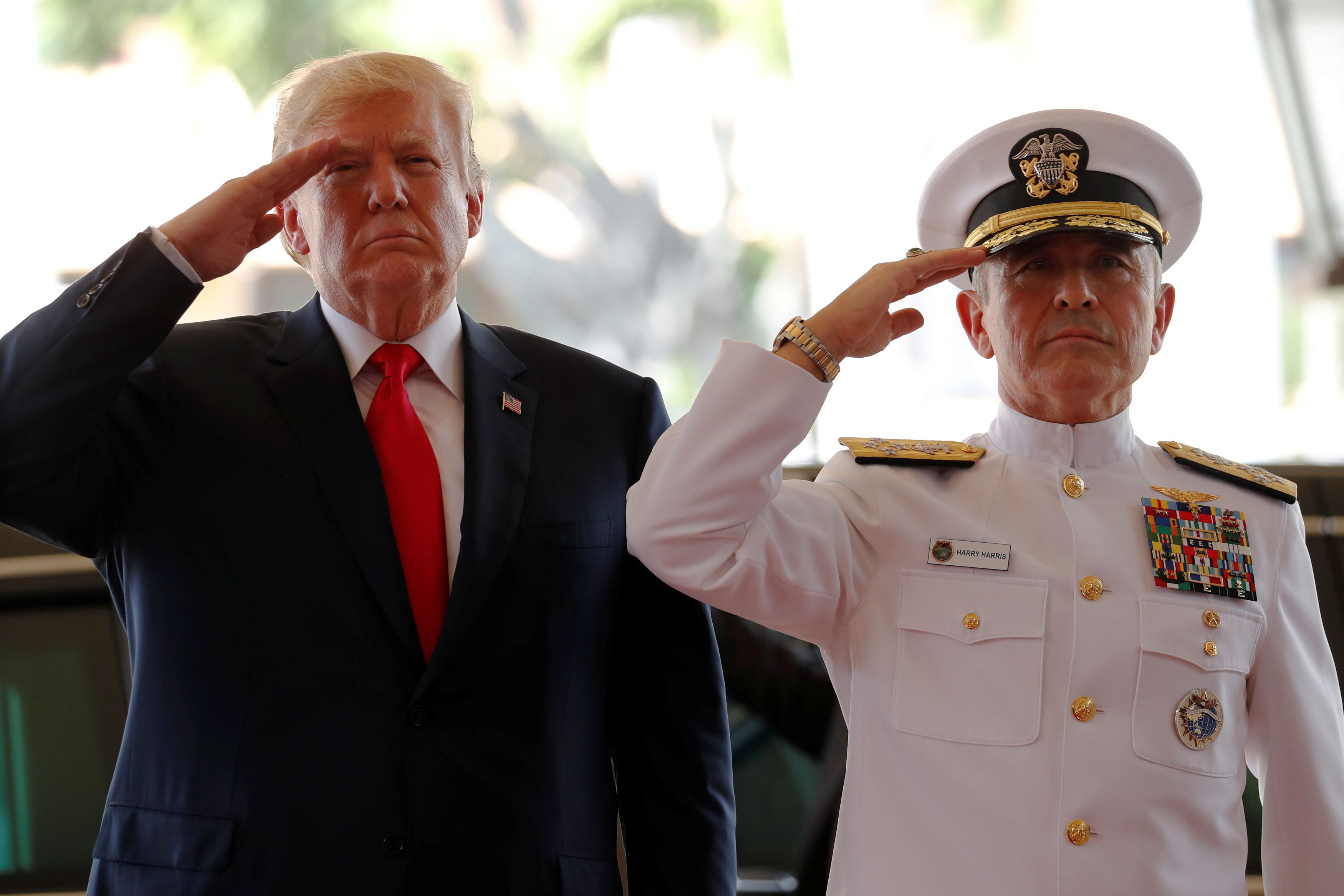 U.S. President Donald Trump is welcomed by U.S. Navy Admiral Harry Harris, commander of United States Pacific Command, at its headquarters in Aiea, Hawaii, U.S. November 3, 2017. REUTERS/Jonathan Ernst