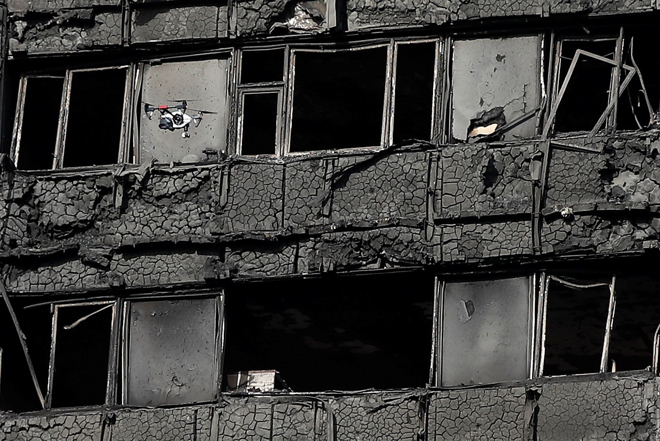 The burnt remains of cladding on the Grenfell