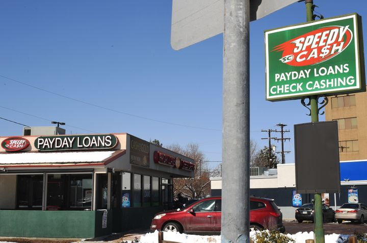 A women walks into the payday lender Speedy Cash on Feb. 21, 2018, in Lakewood, Colorado.