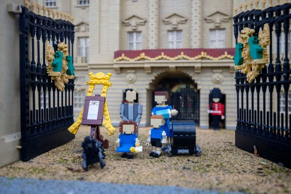 The scene includes a tiny Lego prince at just 3 centimeters tall, along with a 55-Lego brick stroller and the