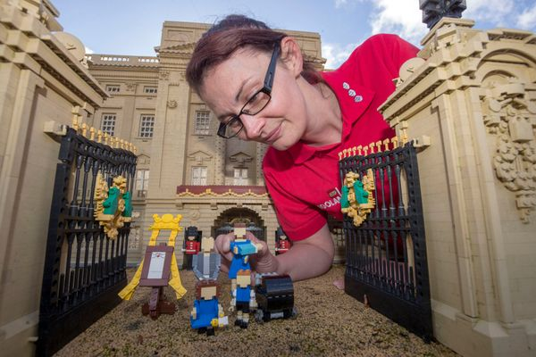 Model maker Kat James puts the finishing touches on the Lego figures.
