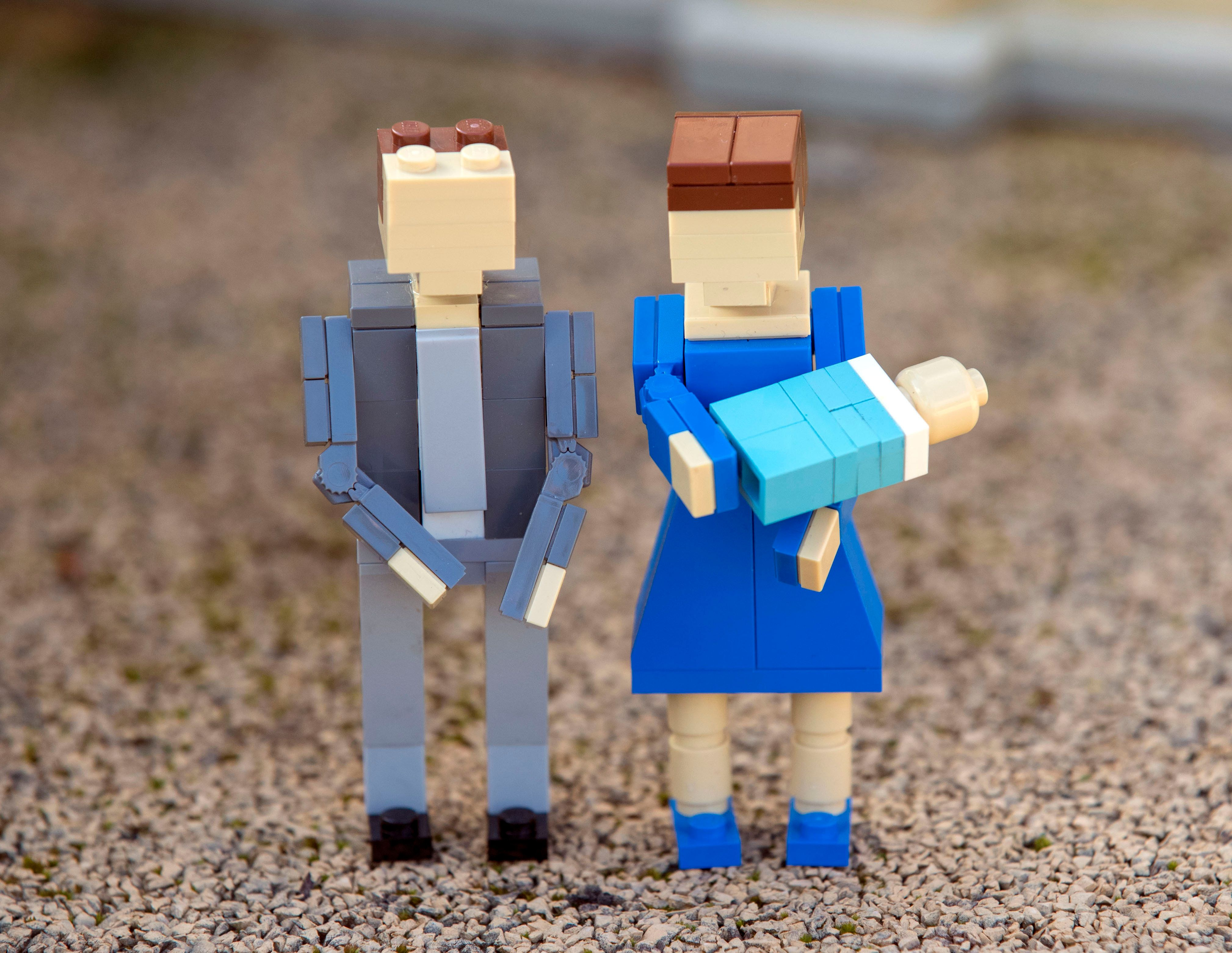 Lego figures of the Duke and Duchess of Cambridge and their new child outside the Buckingham Palace model at Legoland Windsor