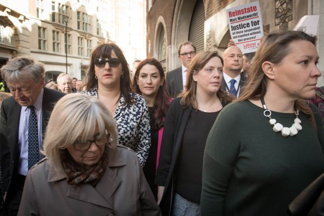 Ruth Smeeth (wearing sunglasses) was flanked by MPs and peers as she went toLabour HQ to give evidence...