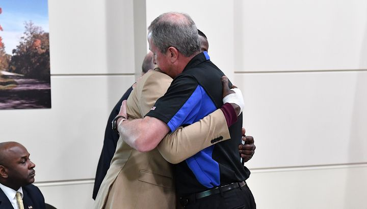 Nashville Waffle House shooting survivor James Shaw Jr. (left) embraces Waffle House President and CEO Walt Ehmer at a press