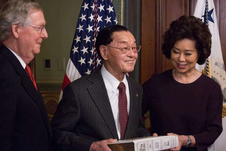 Elaine Chao is seen being sworn in as the transportation secretary with her father, James Chao, holding a Bible. Her hus