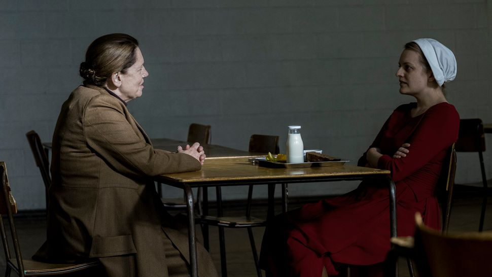 "Offred (Elisabeth Moss) speaks with Aunt Lydia (Ann Dowd) in the Season 2 premiere of ""The Handmaid's Tale."""